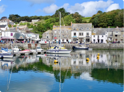 seaside town with boats in the harbour